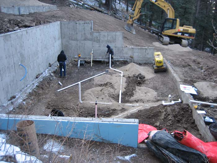 Plumbing is being installed below what will be the basement slab.