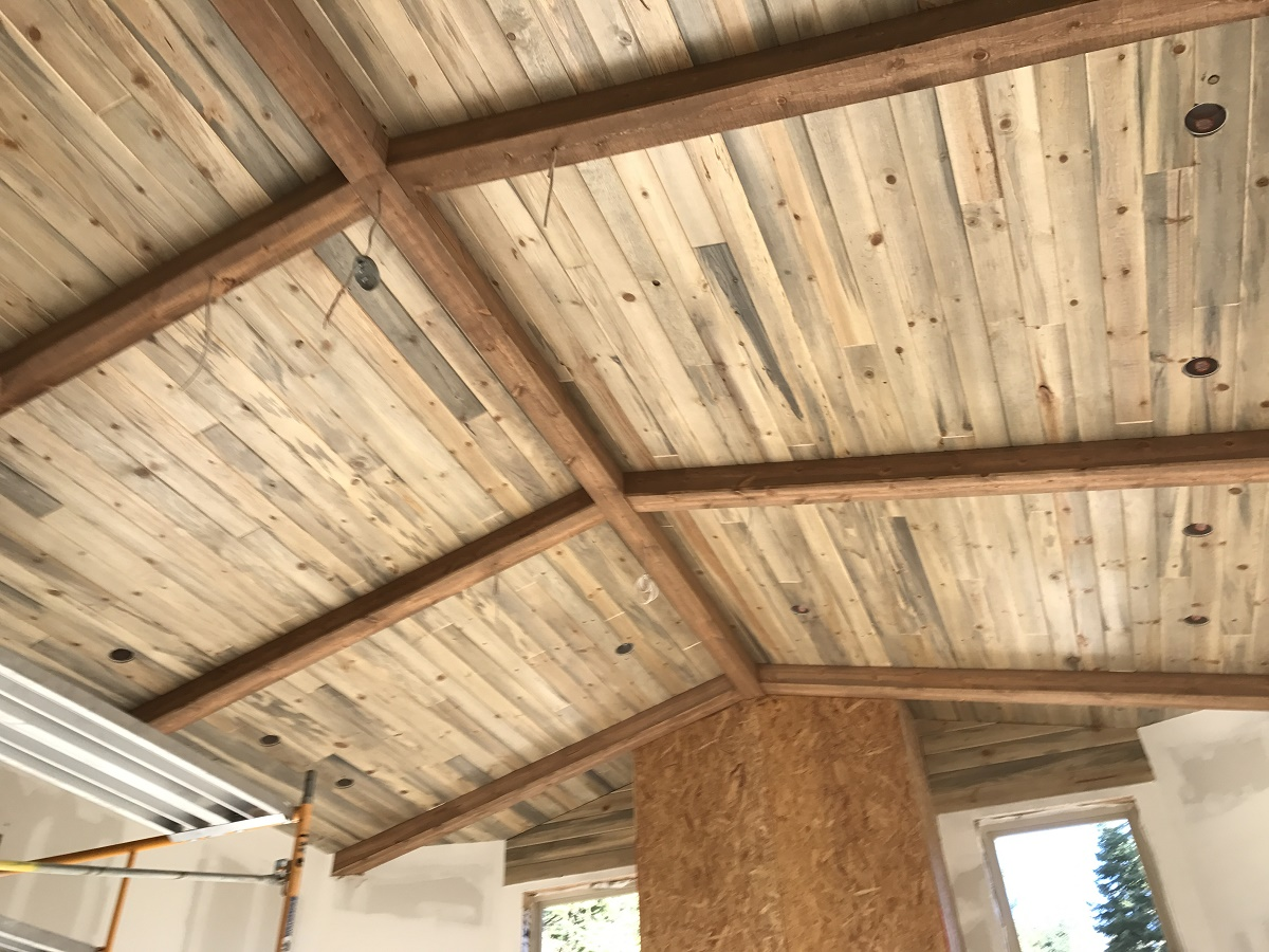 Beetle kill pine ceiling with decorative wood beams make a gorgeous ceiling!-1