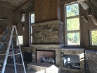Moedl Remodel - Fireplace stone is installed on this Bayfield addition.