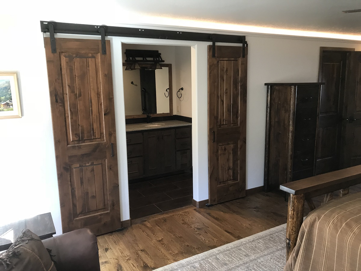 Custom knotty Alder barn doors into the new master bathroom.